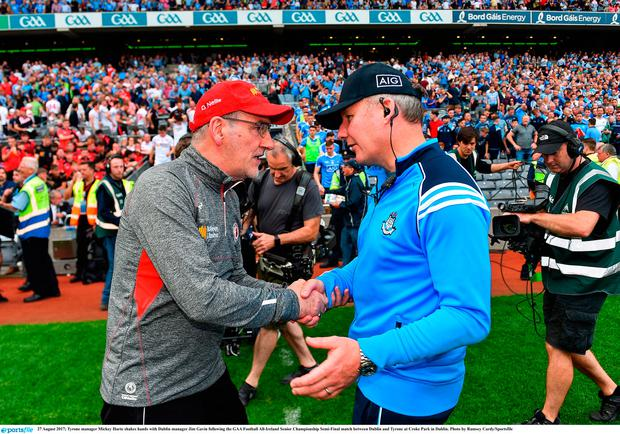 Tyrone manager Mickey Harte shakes hands with Dublin manager Jim Gavin
