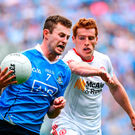 Jack McCaffrey of Dublin in action against Peter Harte of Tyrone