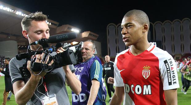 Kylian Mbappe of Monaco during the French League 1 Championship title celebration following the French Ligue 1 match between AS Monaco and AS Saint-Etienne (ASSE) at Stade Louis II on May 17, 2017 in Monaco, Monaco. (Photo by Jean Catuffe/Getty Images)