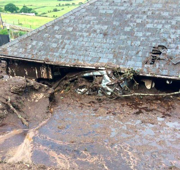 A mud-covered house and yard at Urris in north Co Donegal after last week's deluge