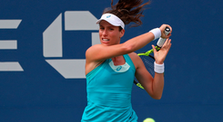 Johanna Konta of Great Britain hits a forehand against Aleksandra Krunic of Serbia (not pictured) on day one of the U.S. Open tennis tournament. Photo: Geoff Burke/USA Today Sports