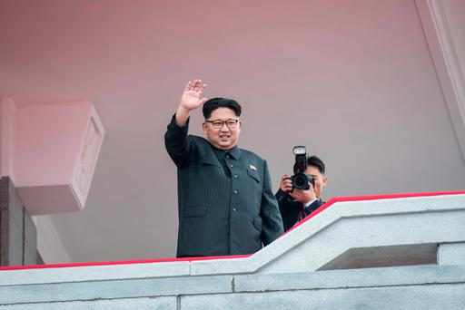 North Korean leader Kim Jong-Un waving from a balcony of the Grand People's Study House to participants of a military parade and mass rally on Kim Il-Sung square in Pyongyang. (AP photo, May 10 2016)