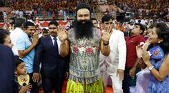 Indian spiritual guru Gurmeet Ram Rahim Singh – pictured, centre, as he arrived for a press conference ahead of the release of his movie 'MSG, The Warrior Lion Heart' last year – has been sentenced to 20 years in prison for raping two female followers. Photo: Tsering Topgyal/AP