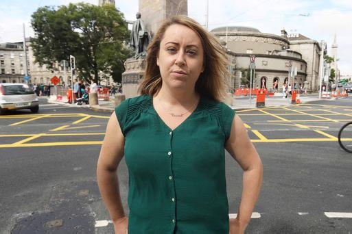 Carly Bailey on O'Connell Street in Dublin City Centre yesterday after the conference on National Day against Child Homelessness. In 2013 Carly lost her family home to a vulture fund as a result of the recession. Photo:Leah Farrell/RollingNew.ie
