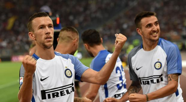 Ivan Perisic (L) of FC Internazionale celebrates the goal 1-3 scored by Matias Vecino of FC Internazionale during the Serie A match between AS Roma and FC Internazionale at Stadio Olimpico on August 26, 2017 in Rome, Italy. (Photo by Giuseppe Bellini/Getty Images)
