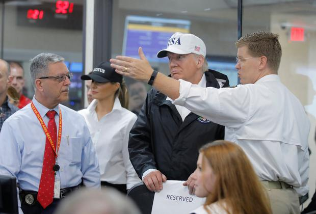 U.S. President Donald Trump (C) llistens during a briefing on Tropical Storm Harvey relief efforts at the Texas Department of Public Safety Emergency Operations Center in Austin, Texas, U.S., August 29, 2017. REUTERS/Carlos Barria