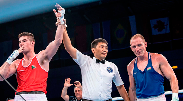 Joe Ward is declared victorious over Mikhail Dauhaliavets following last night's quarter-final. Photo: Sportsfile