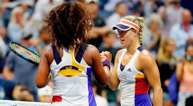 Naomi Osaka of Japan shakes hands after defeating Angelique Kerber of Germany. Photo: Getty