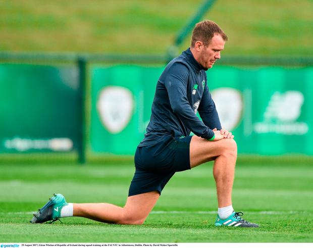 Glenn Whelan does some stretching before training at Abbotstown. Photo: Sportsfile