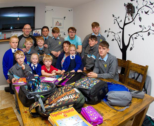 Paul and Edel with their 13 kids ahead of the new school year. Photo: Tom Conachy