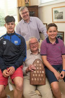 Seán Power holds the hurling medals of his late brother Séamus as he is surrounded by (left to right) grandnephew Donal (a Waterford Under-21 hurler), nephew Tom Power and Ben Horgan, Seán's grandson. Photo: Michael MacSweeney/Provision