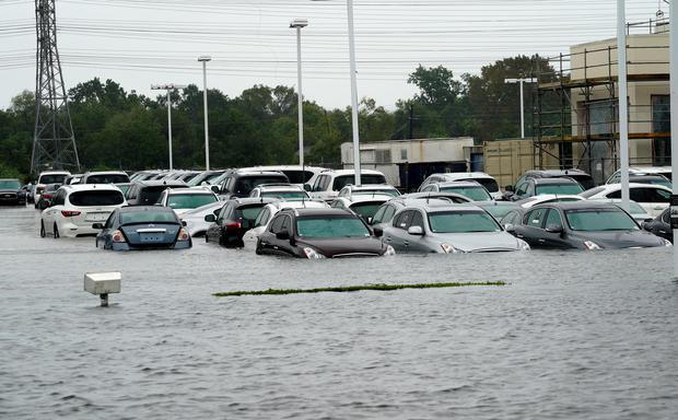 A car dealership is covered by Hurricane Harvey floodwaters near Houston, Texas August 29, 2017. REUTERS/Rick Wilking