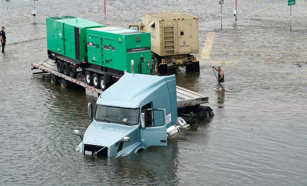 A truck carrying generators is stuck in Hurricane Harvey floodwaters near Alvin, Texas August 29, 2017. REUTERS/Rick Wilking