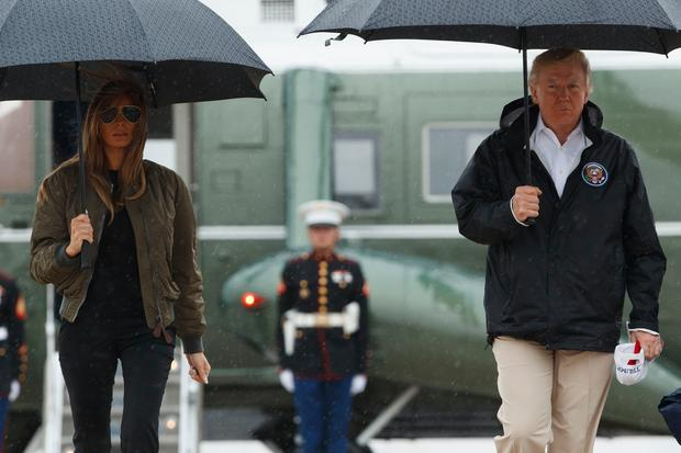 President Donald Trump and first lady Melania Trump walk from Marine One to board Air Force One at Andrews Air Force Base, Md., Tuesday, Aug. 29, 2017, for a trip to Texas to get an update on Harvey relief efforts. (AP Photo/Evan Vucci)