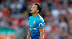 Arsenal's Alexis Sanchez looks dejected during the heavy defeat to Liverpool