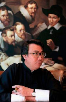 Businessman David Tang, speaks during an interview in his office in Hong Kong, January 1997. REUTERS/Bobby Yip/File Photo
