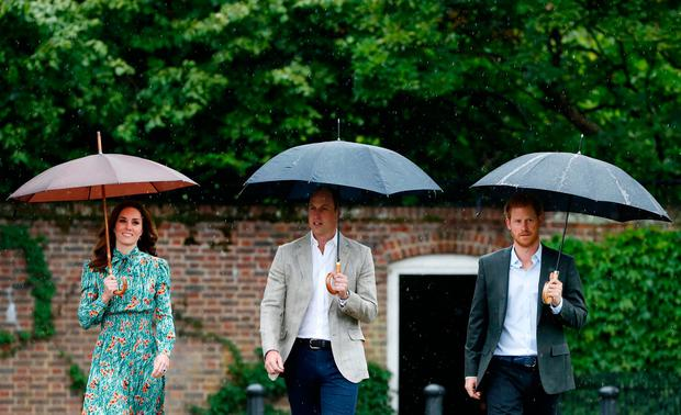 The Duke and Duchess of Cambridge and Prince Harry arrive for a visit to the White Garden in Kensington Palace, London, and to meet with representatives from charities supported by Diana, the Princess of Wales