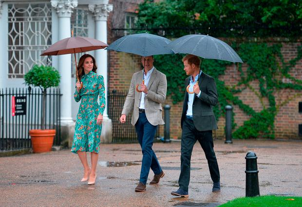 The Duke and Duchess of Cambridge and Prince Harry arrive for a visit to the White Garden in Kensington Palace, London and to meet with representatives from charities supported by Diana, the Princess of Wales