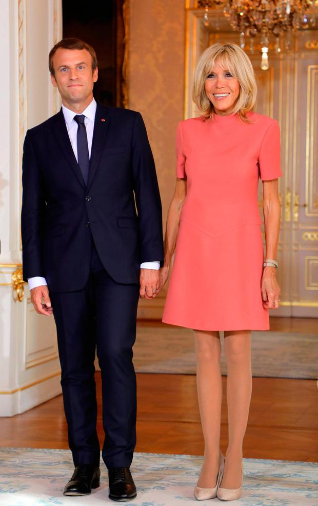 French President Emmanuel Macron and his wife Brigitte Macron pose during a meeting at the Palais grand-ducal in Luxembourg on August 29, 2017. / AFP PHOTO / ludovic MARINLUDOVIC MARIN/AFP/Getty Images