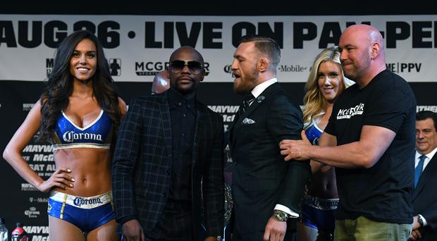 (2nd L-R) Boxer Floyd Mayweather Jr. poses as UFC lightweight champion Conor McGregor is pulled back by UFC President Dana White during a news conference at the KA Theatre at MGM Grand Hotel & Casino on August 23, 2017 in Las Vegas, Nevada. Mayweather and McGregor will meet in a super welterweight boxing match at T-Mobile Arena on August 26 in Las Vegas. (Photo by Ethan Miller/Getty Images)