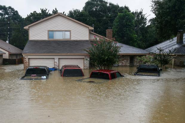 Trucks are submerged on Pine Cliff Drive as Addicks Reservoir nears capacity due to near constant rain from Tropical Storm Harvey Tuesday, Aug. 29, 2017 in Houston. ( Michael Ciaglo/Houston Chronicle via AP)