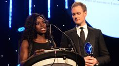 Eniola Aluko and Dan Walker present the Leadership in Sport Award award in association with Nolan Partners to Kelly Simmons at the BT Sport Industry Awards 2016 at Battersea Evolution on April 28, 2016 in London, England. The BT Sport Industry Awards is the most prestigious commercial sports awards ceremony in Europe, where over 1750 of the industry's key decision-makers mix with high profile sporting celebrities for the most important networking occasion in the sport business calendar. (Photo by Anthony Harvey/Getty Images for BT Sport Industry Awards)