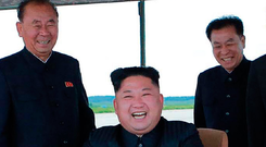 North Korean leader Kim Jong-un, centre, watching the launch of a rocket near Pyongyang. Photo: Getty Images