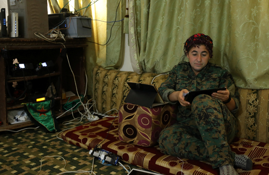 Nowruz Ahmed, general commander of the Women's Protection Unit (YPJ) militia, the Kurdish People's protection unit (YPG)'s all-female brigade, sits inside an operation room in Raqqa, Syria. Photo: Reuters/RodiSaid