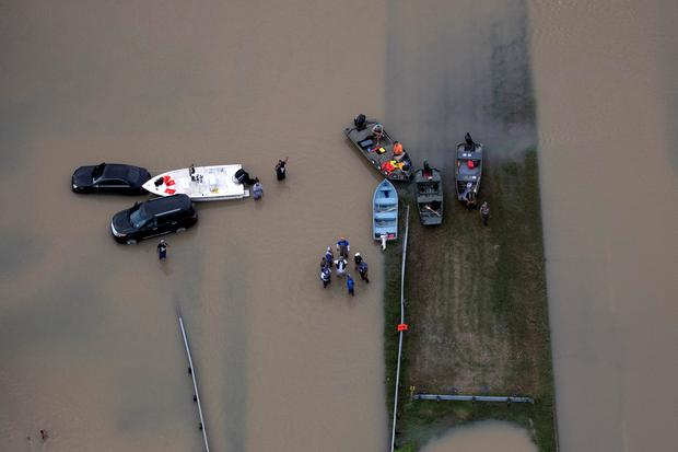 Rescue crews are seen with boats near flood waters brought by Tropical Storm Harvey in West Houston, Texas, U.S. August 30, 2017. Picture taken August 30, 2017. REUTERS/Adrees Latif