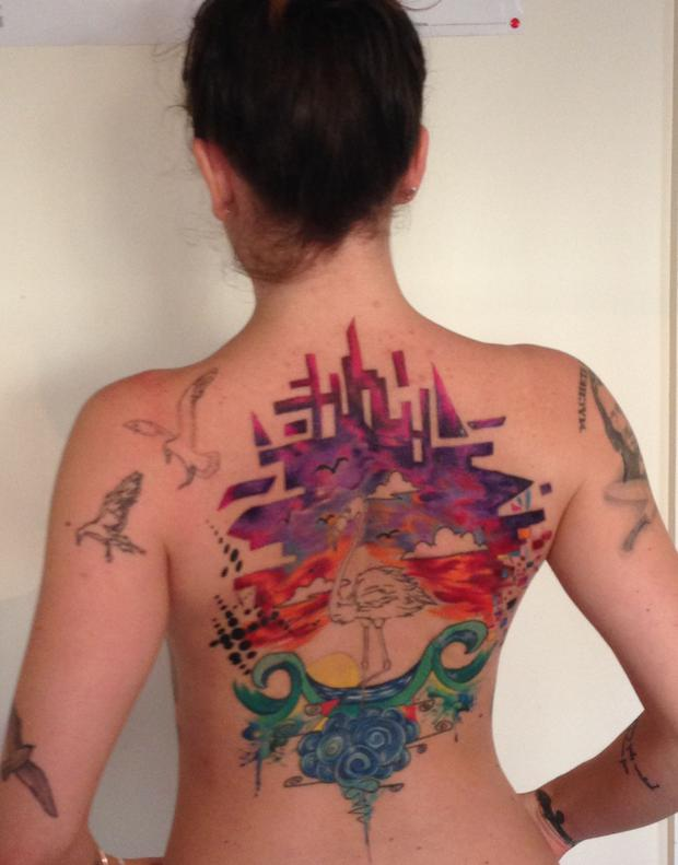 32cd7d7a6 Alessia Taliercio (29) is working on a back tattoo in Dublin's Skin City