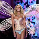 US model Karlie Kloss walks the runway during the 2014 Victoria's Secret Fashion Show at Earl's Court exhibition centre in London on December 2, 2014.