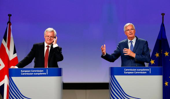 British Brexit Secretary David Davis and EU chief Brexit negotiator Michel Barnier speak after yesterday's talks in Brussels. Picture: Reuters