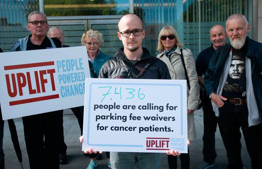 Campaigners including Roderick Campbell (centre) handed in a petition with more than 7,000 signatures urging the RCSI Hospitals Group to scrap the parking fees for cancer patients at their hospitals in Dublin, Cavan, and Louth. Photo: Gareth Chaney/Collins