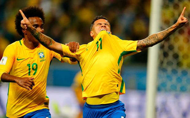 Philippe Coutinho (11) of Brazil celebrates his goal against Ecuador with teammate Willian