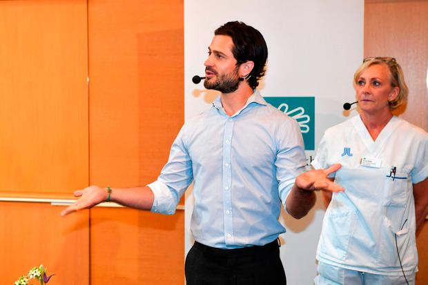 Prince Carl Philip of Sweden (L) meets the media at the Danderyds hospital in North Stockholm where Princess Sofia (unseen) gave birth to a son on August 31, 2017. / AFP PHOTO / TT News Agency / Fredrik SANDBERG / Sweden OUTFREDRIK SANDBERG/AFP/Getty Images