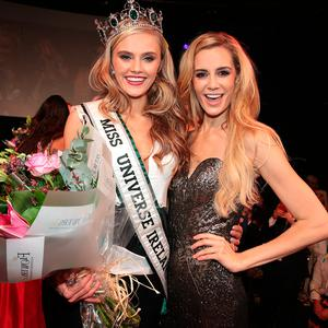 Cailin Aine Ni Toibin from Cork after she was announced winner at the final of Miss Universe Ireland 2017, pictured with Brittany Mason (right)