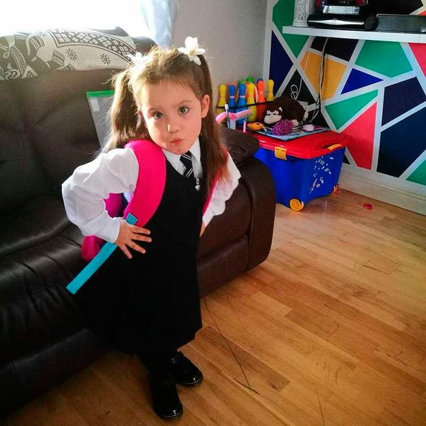 Elliana strikes a pose for her first day at school