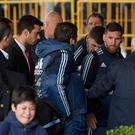Lionel Messi spots the boy after he is led away by security. CREDIT: AFP