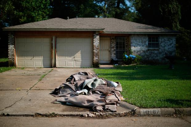 Wet carpets are seen outside of a house damaged by Tropical Storm Harvey in East Houston, Texas, U.S. September 1, 2017. REUTERS/Carlos Barria