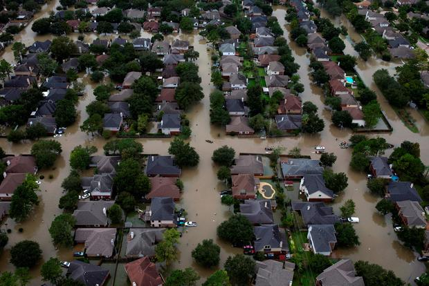 Houses are seen submerged in flood waters caused by Tropical Storm Harvey in Northwest Houston, Texas, U.S. August 30, 2017. REUTERS/Adrees Latif/File Photo