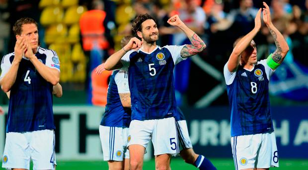 Scotland's Charlie Mulgrew (centre) and his team-mates celebrate after the 2018 FIFA World Cup Qualifying, Group F match at the LFF Stadium, Vilnius