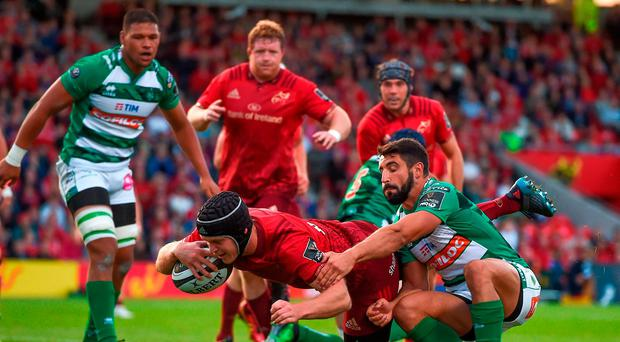 Tyler Bleyendaal of Munster goes over to score his side's second try despite the efforts of Tito Tebaldi of Benetton during the Guinness PRO14 Round 1 match between Munster and Benetton at Irish Independent Park in Cork. Photo by Eóin Noonan/Sportsfile