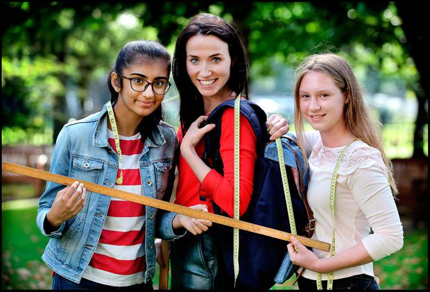 Shraya Sharma (14), from Baldoyle, and Katarzyna Basinska (14), from Bayside, taking final measurements for their 'Tortue' backpack project with a little help from Professor Arlene Gallagher, director of Trinity Walton Club. Photo: Steve Humphreys