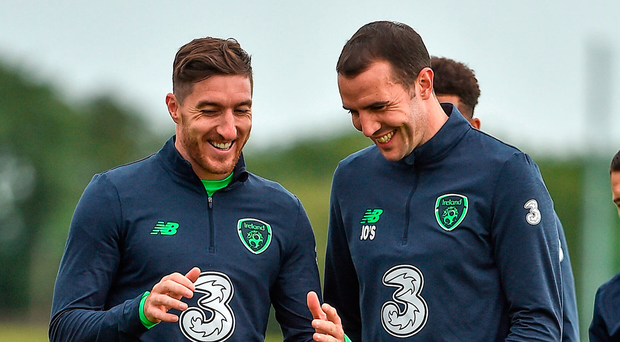 Stephen Ward (left) chats with John O'Shea during training ahead of this evening's game against Georgia Photo: Sportsfile