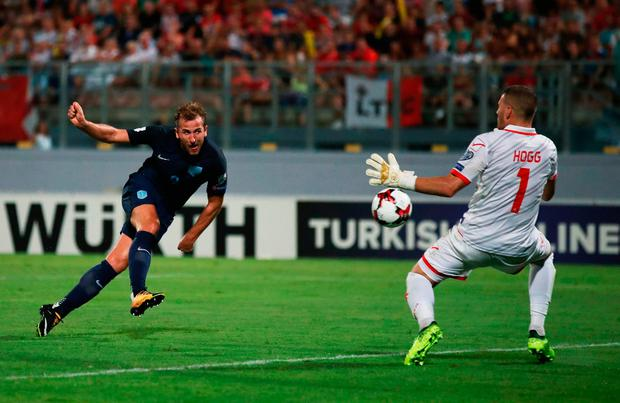 Harry Kane of England scores their fourth goal past Andrew Hogg of Malta Photo: Getty