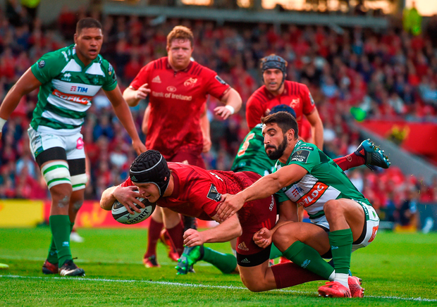 Tyler Bleyendaal of Munster goes over to score his side's second try despite the efforts of Tito Tebaldi of Benetton Photo: Sportsfile