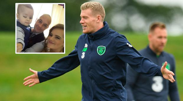 James McClean training yesterday and (inset) little Caleb with mum Jacqueline and dad