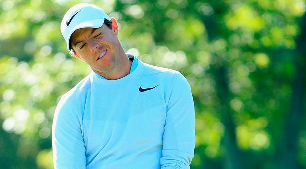 Rory McIlroy reacts after missing a putt on the 13th green