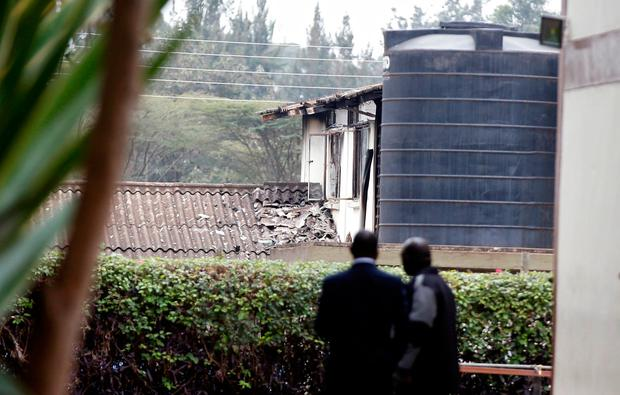 Investigators stand inside a cordon line following a fire that burnt down one dormitory of Moi Girls school in Nairobi, Kenya September 2, 2017. REUTERS/Baz Ratner