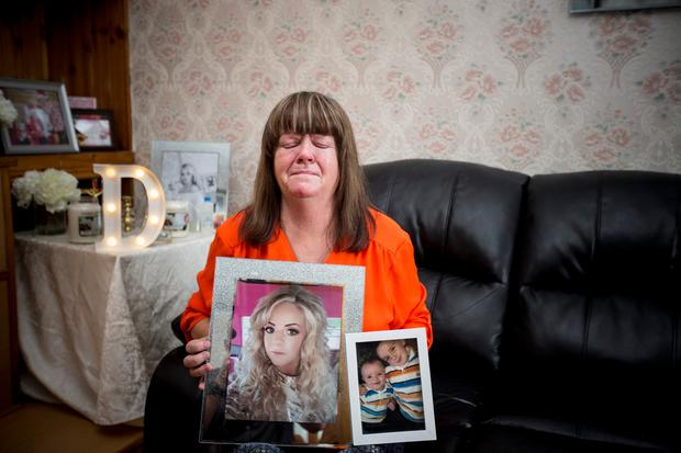Grieving mum Margaret with treasured photos of her daughter Danielle and her two boys Pic:Mark Condren